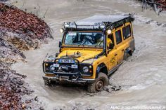 Land Rover Defender 110 yellow in deep mud... Perfect for