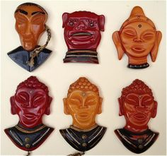 very rare group of Bakelite Asian theme pins including the same pin in three colors on the bottom row