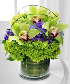 Cymbidium Delight by Mission Viejo Florist If Mom loves orchids, why not send this upscale green Cymbidium orchid design with purple & green hydrangea especially for her?