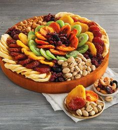 Dried Fruit And Nut Wreath by Harry & David Indian Food Recipes, Gourmet Recipes, Appetizer Recipes, Snack Recipes, Healthy Recipes, Snacks, Charcuterie Recipes, Charcuterie Platter, Dried Apples