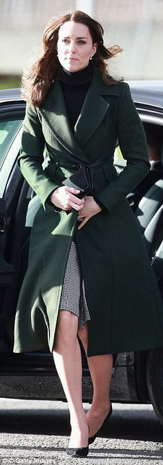 Kate arrives for an official visit to Scotland on 24 February in a£940 Sportmax coat and £475 skirt by Le Kilt