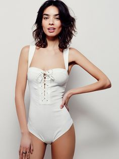 Philo Bodysuit | In a stretchy fabric, this bodysuit features lace-up detailing on the placket. Hidden snap closures on the gusset.