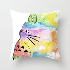 """If your aim is to brighten up the nursery room remember some galleries offer prints on cushions. How about this """"My Rainbow Totoro"""" Throw Pillow? Also available as print."""