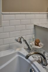 Kohler Maripossa soaking tub with Devonshire roman tub and Bancroft hand held