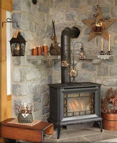 We have a wood stove that I'd love to have a stone wall behind to complete the r.,We have a wood stove that I'd love to have a stone wall behind to complete the rustic look. What is wood burning ? The pine burned by shading approach. House Design, House, Home, Cabin Decor, Stove Decor, Wood Stove Decor, Fireplace, Pellet Stove, Rustic House