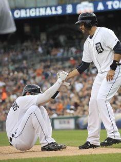 Tigers' J.D. Martinez (28) helps up Nick Castellanos
