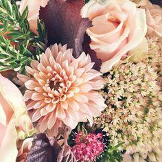 gorgeous flower arrangement of dahlias & roses