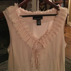 """Pretty sleeveless boutique Top  This top is so pretty and feminine, yet so so comfy! 60% cotton,40% modal. It's very soft and the ruffle adds such a unique touch! Size XL. 19.5"""" across bust, 21"""" across bottom of shirt. No tags but never worn. Bundle 2+ items for 20% off! Tops"""