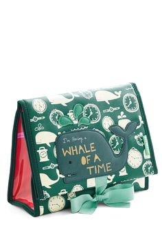 Fare Thee Whale Makeup Bag. For your seafaring vacation, keep your cosmetics safe in this ocean-themed makeup bag by Disaster Designs. #green #modcloth