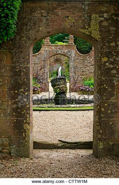 The walled gardens and water features Athelhampton House in Dorset - Stock Image