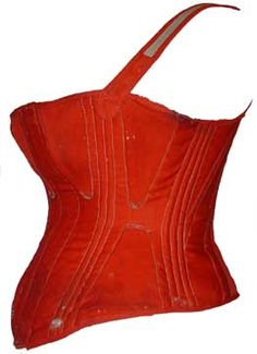 Red wool became fashionable for undergarments at the end of the 1850's and was used for petticoats, cage crinolines and corsets. Although fashionable in color, the stays would have been quite unfashionable in construction with the use of shoulder straps, large triangular bust and hip gussets as well as having a closed front instead of a split busk. This pair of stays would have used a long, rigid busk made from ivory, wood, metal or whalebone inserted into the front slot of the corset. The…