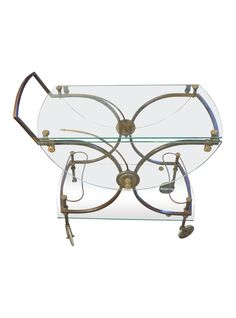 Love the see-through sass of this French Bar Cart/ Tea Cart In Glass and Brass  | The HighBoy | www.thehighboy.com