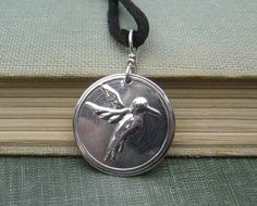 """Sweet  Hummingbird Sterling Silver Stamped by nicholasandfelice, (I'd put on a little silver chain)$14.00  We handcarved the stamping die ourselves in reverse (back when we had a lot more free time) and stamped it into the 3/4""""(1.9cm) diameter sterling silver 30 gauge disc with our little hydraulic press and tumbled it up for a nice polish.  See all our designs available for purchase in our Etsy shop-nicholasandfelice.etsy.com"""