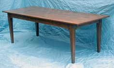 French reproduction antique farm style table, an original design with straight legs.  Each table is custom built and can be ordered in many sizes, colors and options.