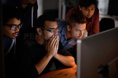 Shot of a group of young designers staring tensely at a monitor - stock photo #1157098