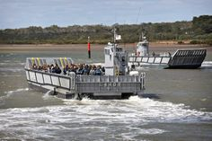 Two LHD Landing Craft transport recruits role-playing as civilian evacuees from the HMAS Cerberus wharf to HMAS Adelaide in Westernport Bay. (photo: LSIS Nina Fogliani)