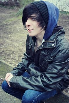 he's actually attractive, alot scene guys hide their faces so much that you can't tell whether they're cute or not.