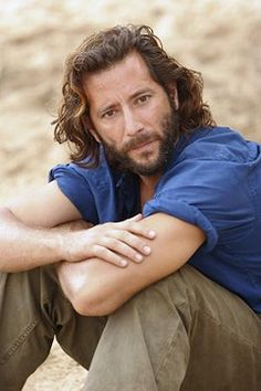 Henry Ian Cusick as Desmond Hume on 'Lost'. His angst makes me want to lick his face. Is that weird?