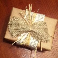 Easy gift wrapping with house hold things!  I used raffia, a paper sack and burlap! So cheap!
