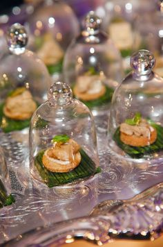 How chic are these miniature appetizers covered with bell jars?