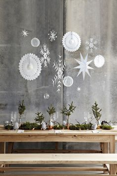 an inexpensive table decoration for Christmas. Cut off branches of your Christmas tree and put in glasses for instant table decorations.