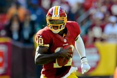 Robert Griffin III Practices, Still Not Cleared to Play for Redskins 10/10/2012