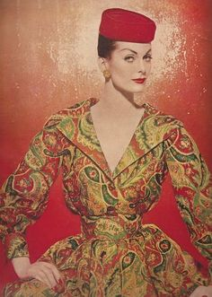 Carmen Dell'Orefice in a 1950's paisley pattern silk dress and red pillbox hat. Look how tiny her waist is!