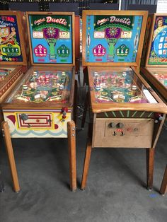 1955 Gottlieb Duette (left) and Duette Deluxe electromechanical pinball machines.