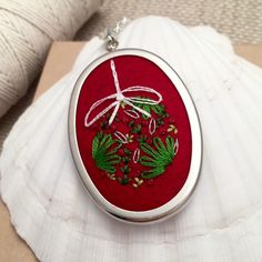 How cute is this hand embroidered pendant necklace? It would make a great gift. Or treat yourself!   https://www.etsy.com/listing/253713941/embroidered-necklace-embroidery-jewelry