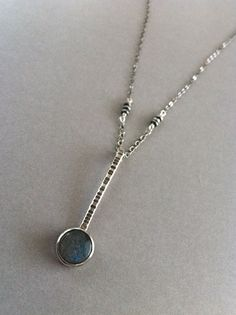 This might be my favorite: handmade silver etched post with bezel set labradorite necklace