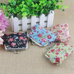 $0.58 (Buy here: https://alitems.com/g/1e8d114494ebda23ff8b16525dc3e8/?i=5&ulp=https%3A%2F%2Fwww.aliexpress.com%2Fitem%2FDurable-2016-Fashion-Lightweight-Cotton-Wallets-for-Women-Lady-Retro-Vintage-Flower-Small-Wallet-Hasp-Purse%2F32717438313.html ) Durable 2016 Fashion Lightweight  Cotton Wallets for Women Lady Retro Vintage Flower Small Wallet Hasp Purse Clutch Bag  for just $0.58
