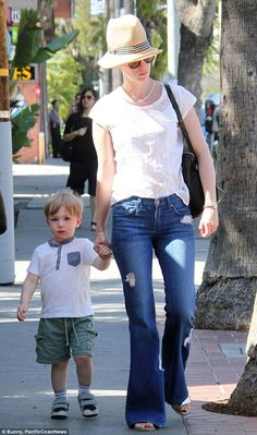 January Jones wears James Jeans Play Girl in Wimbledon while out in LA with son Xander. Can't believe how much he's grown! Click now to shop her style!