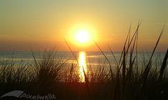 Foto Sonnenuntergang im Meer von Ahrenshoop auf der Halbinsel Fischland-Darß-Zingst