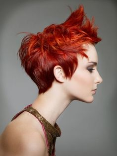 Wow! This fiery red pixie is simple amazing. The stylist behind this haircut is brilliant combining a messy look to this cut that almost looks like flames coming out of her hair to accentuate the scorching red color chosen in this look.