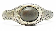 This is rare medieval stirrup shaped silver finger ring, dating to the 13th - 14th century. The ring is set with a toadstone. The toadstone was a powerful and precious gem from the Medieval and Tudor period. It was thought to protect from poison, snake venom and enchantments by witches. FOR SALE: www.ancient-jewellery.com