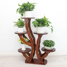 You can place 5 flower pot on this great flower rack easily, It add some fresh air for your home, also quite amazing view. House Plants Decor, Plant Decor, Indoor Plant Shelves, Decoration Plante, Decorating Bookshelves, Solid Wood Flooring, Diy Plant Stand, Indoor Flowers, Wall Decor