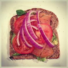 Avocado and lox on Ezekiel bread.