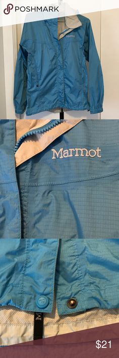 Bright blue Marmot rain jacket with hood Fun blue Marmot rain jacket. Lightweight. Two front pockets and zippers under arms for breathability. Hood. Elastic cord at bottom to tighten or loosen fit. Some small dirt marks (see picture). Marmot Jackets & Coats Utility Jackets