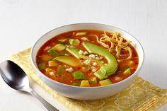 Savor this rich tortilla soup with fresh avocado, queso fresco cheese, tortilla…