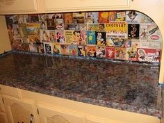 picture of backsplash I decoupaged using vintage drink advertisements and labels. The countertops I painted to look like granite.
