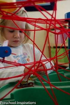 Create a hands on spider web. Spiders in the Sensory Table by Preschool Inspirations