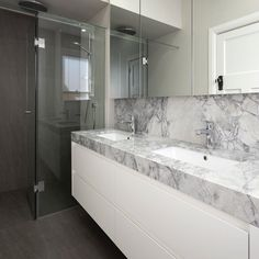 """CDK Stone on Instagram: """"Neolith Basalt Grey on the floor and in the shower makes for few grout lines and easy cleaning. Super White on the vanity makes a stunning…"""" Natural Stone Bathroom, Natural Stones, Super White, Grout, Double Vanity, Countertops, Bathrooms, Cleaning, Flooring"""