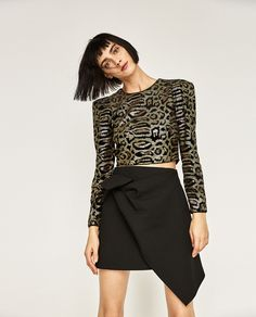 Image 1 of MINI SKIRT WITH KNOT from Zara
