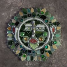 Garden ornament out of broken china and glass beads/marbles