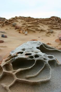 Erosion Art, stone and sand.  https://secure.flickr.com/photos/brothergrimm/2278733150/sizes/l/in/photostream/