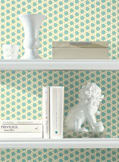 Add a small graphic wallpaper print behind your bookshelves. So fun!