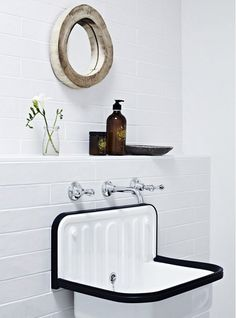 Crisp and white bathroom with rustic mirror