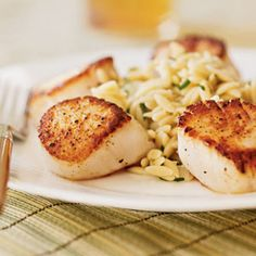 Seared Scallops with Lemon Orzo.     ½ cup prechopped onion   1 cup uncooked orzo (rice-shaped pasta)   1 cup fat-free, less-sodium chicken broth   ½ cup dry white wine   ¼ teaspoon dried thyme   2 tablespoons chopped fresh chives   2 tablespoons fresh lemon juice   2 teaspoons olive oil   1½ pounds sea scallops   ¼ teaspoon salt   ¼ teaspoon black pepper