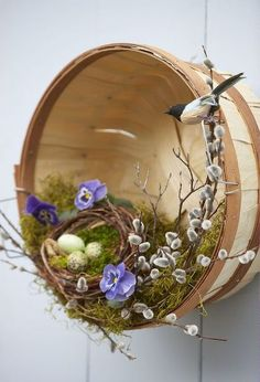 easy easter decorating, christmas decorations, easter decorations, seasonal holiday d cor, Old baskets and some simple flowers fake birds butterflies and Easter eggs create an attractive door piece or walkway accent