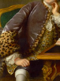 Leopard fur-lined  (puce?) silk frock coat with large upturned leopard fur cuffs, and showing at edges, with same silk fabric covered buttons; gold thread floral embroidered oyster-silk waistcoat with gold buttons; lace at wrists; white silk stockings rolled over knee. Detail from Portrait of a Man Seated at a Desk, ca. 1750, by Marianne Loir (French, ca. 1715-1769). See portrait: http://www.pinterest.com/pin/278589926924302311/